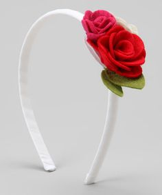 Transform tresses into a blooming garden with this cool accessory. This ribbon-wrapped headband slides easily into any hairdo.Fits ages 2 to 10 yearsMade in the USA