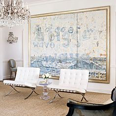 Love the barcelona chairs and the hugh art.