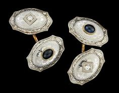 Gentleman's platinum and 14 karat yellow gold cufflinks Unusual platinum topped highly etched cufflinks, one side diamond chip set, the other side set with a cabochon sapphire.