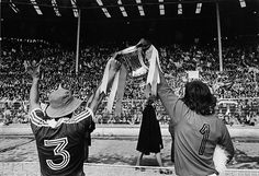 Credit: Eamonn McCabe/Guardian 1977/78, Ipswich Town v Arsenal Ipswich captain Mick Mills and Ipswich goalkeeper Paul Cooper, right, show off the FA Cup trophy to the Ipswich fans. Credit: Eamonn McCabe