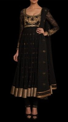 An embroidered flared suit in soft nylon net with a black jersey churidar