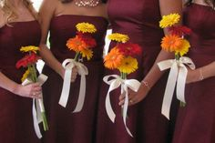 Simple Gerber daisy bouquets...minus the ribbon