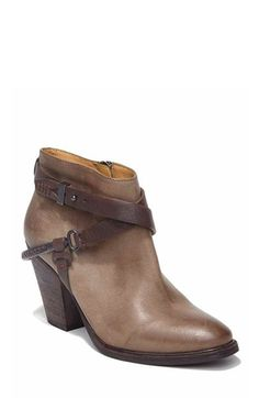 The leather strap details on this ankle boot give a little bit of a western feel, but the slick material and cut makes it just as appropriate for city dwellers.  $94.90, Dolce Vita.   - Redbook.com