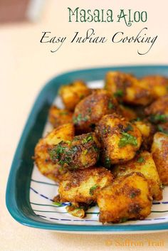 Masala Aloo recipe - One of the most popular recipes on my blog - this recipe for an Indian style Masala aloo will be your favourite way to cook potatoes.