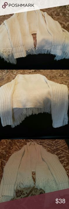 Gorgeous and Warm VS Shrug. Oversized Medium. Off white thick sweater shrug by Victoria's Secret. Looks almost like a beautiful shawl with sleeves. Dresses up and down. Only worn 2 or 3 times. In excellent condition. No stains or flaws. Like new. Victoria's Secret Sweaters Shrugs & Ponchos
