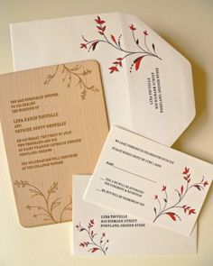 I like the flowers and elegant simplicity of these invitations, although I think I want a different wording and no RSVP envelope.