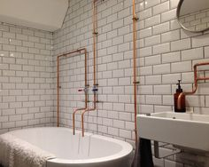 Jenny created an industrial look in her bathroom by combining white metro tiles with bare copper piping and other vintage elements...