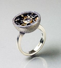 Custom designed and commissioned rings made by Andy Cooperman for clients.