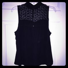 Black Sleeveless Blouse w/ Lace Detail This is a black top with a lace collar on the top (both sides). The bottom is flowy and loose and it is the perfect top to pair with pants, jeans, a skirt or even a pair of shorts. (versatile) It is a fun top and perfect for any occasion. 👯💋🎁 Tops Blouses