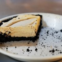 Super Easy Peanut Butter Pie Recipe- Use a prepared oreo crust. Top with cool whip topping then drizzle hot fudge sauce and  chopped up reeses cups.