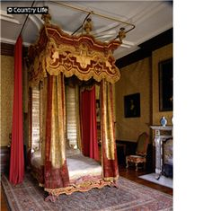 """Dyrham House (National Trust) ~ Locate near Bathy and the late 17th-century home of William Blathwayt, a hard-working civil servant.  Served as the site of the gorgeous  movie, """"The Remains of the Day."""" Here, the state bed in fringed velvet and sprigged satin, complete with its protective case curtains, ca. 1704.   [2ndof three pins]"""