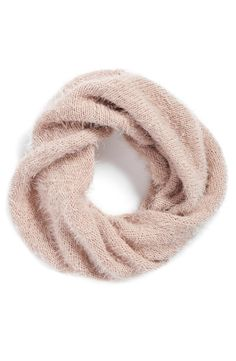 Rejuvenate any fall look with this irresistibly fuzzy pink infinity scarf.