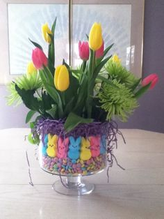 Learn how to make Easy Dollar Store Easter Table Centerpieces - Spring Flowers with Peeps! All you need are a few supplies you can be pick up at your local dollar store for these gorgeous Spring decorations! Easter Flower Arrangements, Easter Flowers, Flower Centerpieces, Easter Centerpiece, Table Centerpieces, Spring Flowers, Easter Peeps, Easter Candy, Hoppy Easter