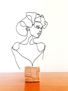 This expressive sculpture in wire is a sophisticated young lady. A woman with…