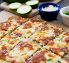 These cheesy breadsticks are so tasty, you won't miss the carbs. Zucchini is transformed into bread and baked with cheese for a low-carb and keto-friendly alternative to traditional breadsticks. Zucchini Cheese, Zucchini Pizzas, Zucchini Bread, Zucchini Sticks, Cheese Bread, Sliced Zucchini Recipes, Indian Food Recipes, Italian Recipes, Vegetarian Recipes