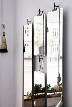 vertical mirrors are hung from industrial hardware via The Shop Of The New, Copenhagen. / sfgirlbybay