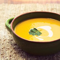 Earthy parsnips and sweet carrots come together in this creamy spiced soup. A perfect start to Thanksgiving dinner.