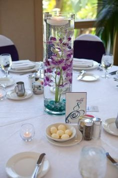 This center piece is cool, I like the sunken flowers but would change the colors to purple and silver