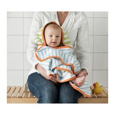 STÄNKA Baby towel with hood IKEA Cotton is soft against your baby's skin and highly water absorbent.