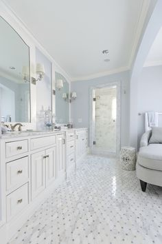 Meredith Heron Design - bathrooms - white and blue bathroom, wall to wall vanity, white marble countertop, arched vanity mirrors, his and her sinks, marble diamond tiled floor,