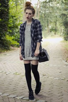 Soft grunge look with plaid, platforms, and a statement dark lip.