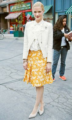 Hart of Dixie  Season 2, Episode 17 Lemon Breeland (Jaime King) wears a white ruffled Ralph Lauren blouse, structured white Maje jacket, printed orange Akris skirt, Valentino heels, and a bracelet by Maximal Art.