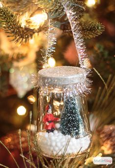 Blog post at Atta Girl Says : Use recycled glass jars and miniatures to make these adorable DIY Christmas snow globes for your tree.  My mom used to collect Christmas s[..]