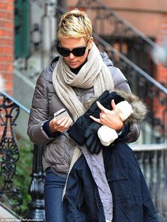 Juggling act: Charlize Theron showed off her wintry style while combating the 30-degree temperatures as she strolled through Boston with a m...