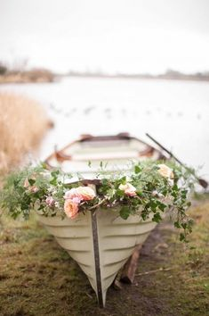 Rowboat adorned with fresh flowers.
