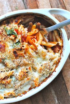 Baked penne with spinach and tomatoes