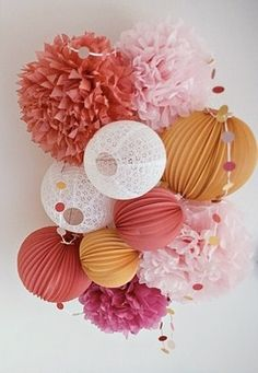This is a mash-up of a few craftacular projects on Pinterest.  Pom poms, doily lamps, garlands, and round accordions.