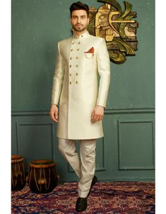 Off White Colour Indian Designer Indowestern with pants is part of Sherwani - Make a classy impression, dressed in this Off White Colour Jacquard,Imported Fabric Men's Indo Western All patterns are intricately embellished with Embroidered Work Sherwani For Men Wedding, Wedding Dresses Men Indian, Sherwani Groom, Mens Sherwani, Wedding Dress Men, Wedding Wear, Wedding Outfits, Indian Weddings, Wedding Couples