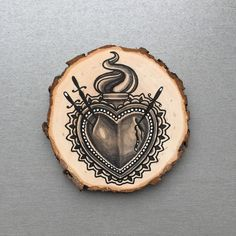 Wood slice with an original drawing of a sacred heart 'tattoo style'