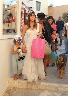 Little Streets and Tiny Boutiques | Kourtney Kardashian She is wearing a Johnny Was dress, a Eugenia Kim headband from DASH, Pucci sandals, and a Celine bag. Mason is wearing a Nico Nico romper, Freshly Picked moccasins and a hat from Mykonos.