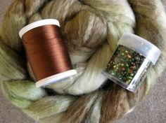 Spinning a beaded art yarn from Ennea Collective. Instructions on how to make a beaded yarn with a singles and a thread.