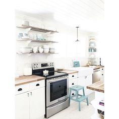 Amanda ••• Natural Mommie @naturalmommie Instagram photos | white farmhouse kitchen with white subway tile, barnboard open shelving, butcher block, farm sink, planked ceiling