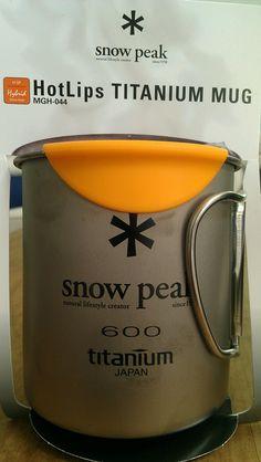 "Snow peak titanium mug with silicon ""hot lips"" to prevent burns."