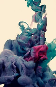 The Italian artist Alberto Seveso takes pictures of ink in different colours blending into water.