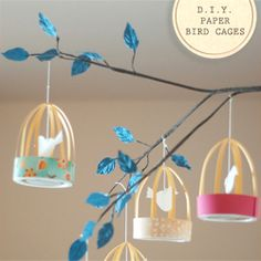 Paper Bird Cage Party Decor #craftgawker followed the tutorial except we stapled the patterned paper ring and didn't use any lids (just left the bottom open). We wrote the girl's names on the birds for place cards.