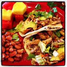 Marinated and Spiced Dry Rubbed Grilled Mahi Mahi Fish Tacos with Avocado, Cabbage, Red Onions, Cilantro and Tomatoes; Spicy Pinto Beans and Fresh Pineapple and Watermelon