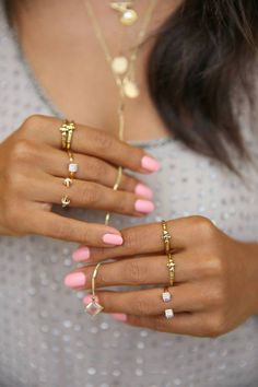 Gold knuckle rings with a pink mani. Too cute!