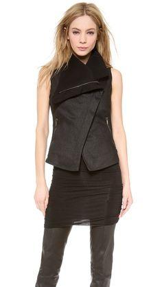 Asymmetrical zip vest.  Center back and back princess seams, back hemband.  Front zip pockets, no hemband.  Slight hi-low hem.  Stretch denim, fleece lining.