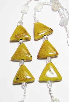 Mustard Gold Porcelain Triangles with White Glass by tzteja, $20.00