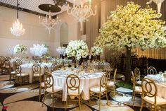 Gold, yellow, and white wedding decoration | Project by Paper Cranes Productions http://www.bridestory.com/paper-cranes-productions/projects/dennis-hue-s-wedding-cinematic-portraiture-i-promise-to-share-my-chips-with-you