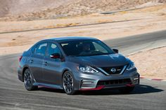 st.motortrend.com uploads sites 5 2016 11 2017-Nissan-Sentra-NISMO-front-three-quarter-in-motion-12.jpg