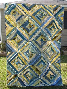 I made this quilt for my amazing MIL who gave up a month of her life to help my husband and I after the birth of my daughter. When I think of her, blue and yellow come to mind...so this is the quilt that came of that. blogged here
