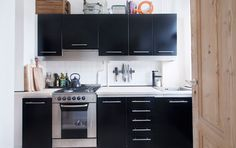black cabinets in a small kitchen