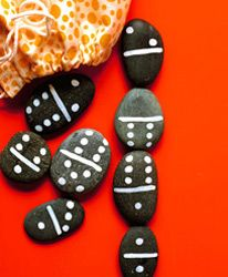 rock dominoes. Lovely idea for a walk with the little ones, collect them, then take them home to paint and play!