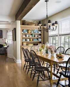 White blinds are a classic choice for this beautiful country home.