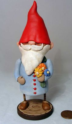 Spring Time Gnome original fok art sculpture Blue jacket Janell Berryman signed. $95.00, via Etsy.